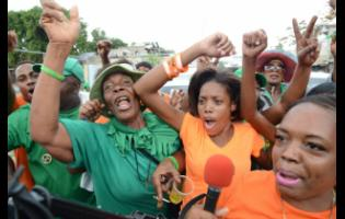 Supporters of the Jamaica Labour Party and People's National Party cheering for their respective candidates during Nomination Day 2016.