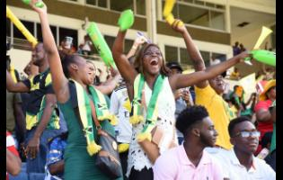 FILE Supporters of the Jamaica Tallawahs celebrate their team's first win of the 2019 Caribbean Premier League campaign after they defeated the  Barbados Trident at Sabina Park on Sunday, September 15, 2019.