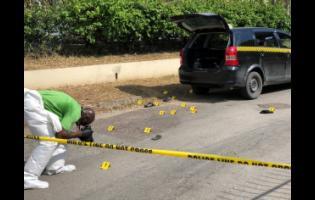 Personnel process the crime scene.